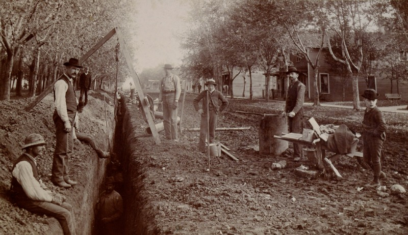 Crew laying water or sewer pipes, Worthington